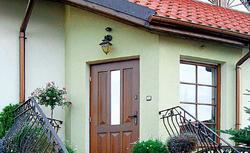 Drzwi drewniane, metalowe lub z PCV. Wybierz ładne i energooszczędne drzwi wejściowe